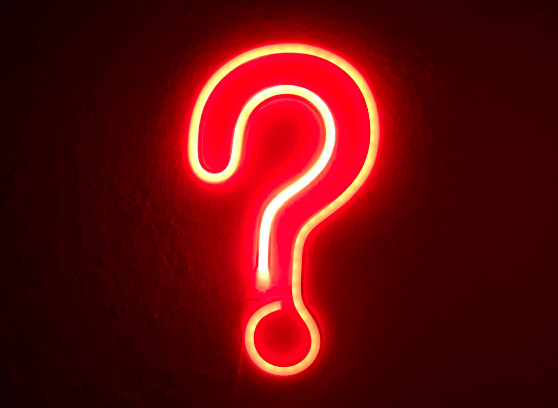 Red neon sign question mark