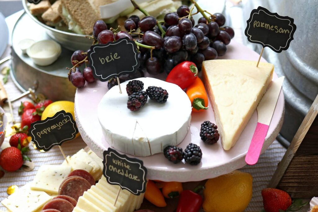 Cheese plate with Brie, Parmesan, Pepperjack and white Cheddar cheeses