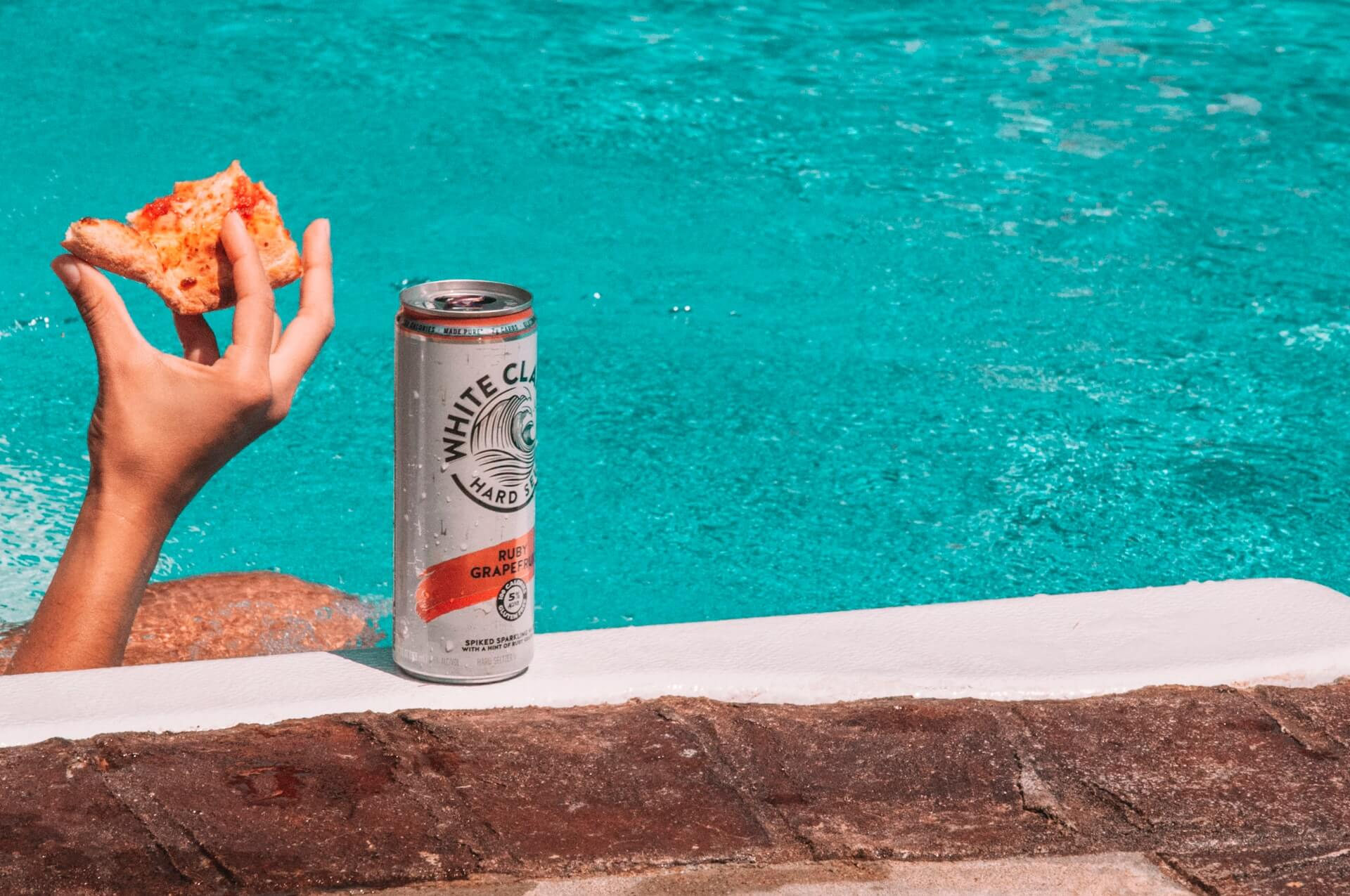 White Claw Ruby Grapefruit and pizza poolside
