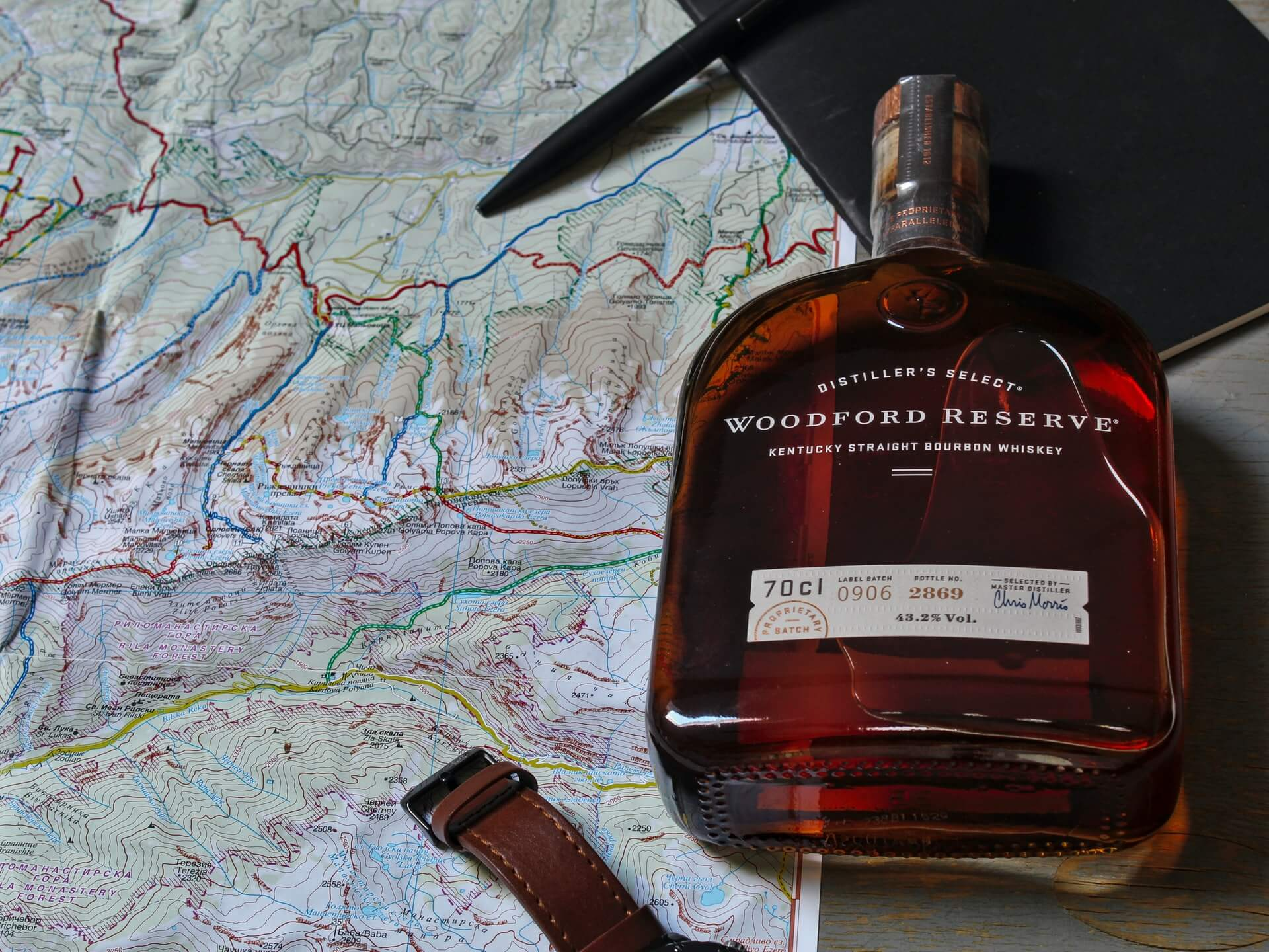 Bottle of Woodford Reserve Distiller's Select Kentucky Straight Bourbon on top of a map