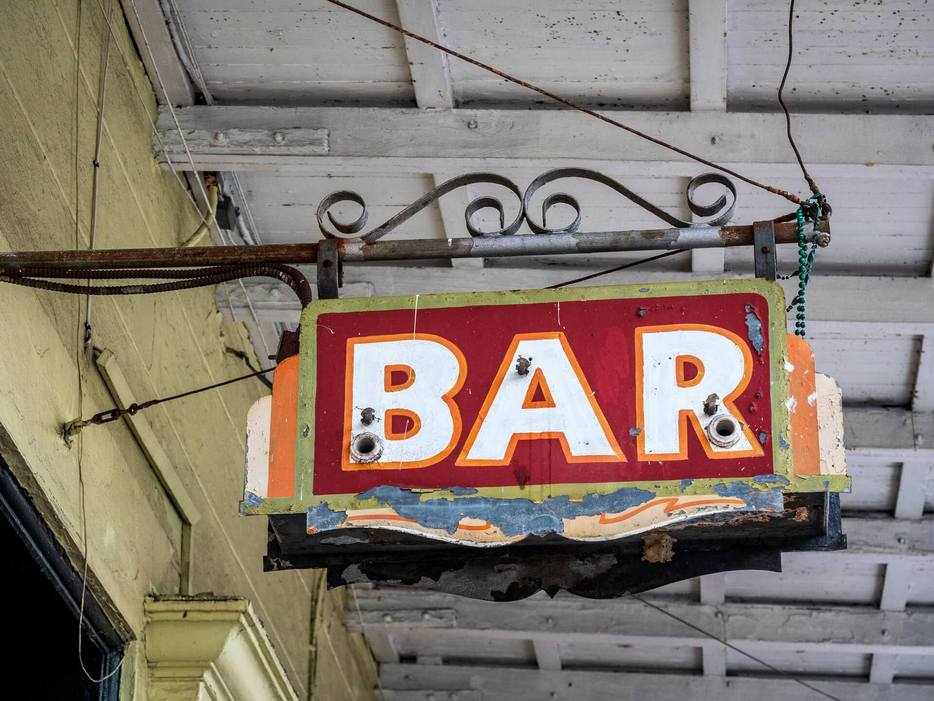 Old bar sign hanging in the French Quarter of New Orleans, Louisiana