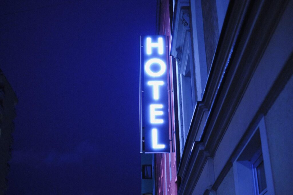 Lit neon hotel sign with blue and purple background