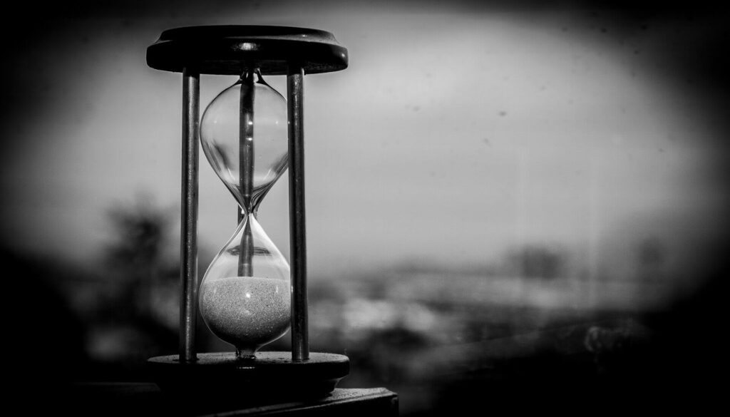 Time has run out hourglass, black and white